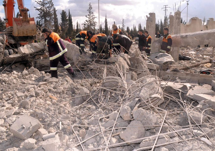 In this photo released by the Syrian official news agency SANA, Syrian rescue workers remove wreckage from the Syrian military intelligence building at a security compound which was attacked by an explosion, in the northern city of Aleppo, Syria, on Friday Feb. 10, 2012. (AP Photo/SANA)