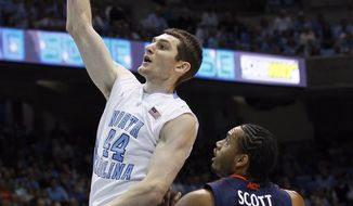 North Carolina's Tyler Zeller had 25 points and nine rebounds in UNC's 70-52 win over Virginia. (AP Photo/Gerry Broome)