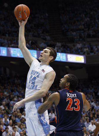 North Carolina's Tyler Zeller had 25 points and nine rebounds in UNC's 70-52 win over Virginia. (AP Photo/Gerry Broome)