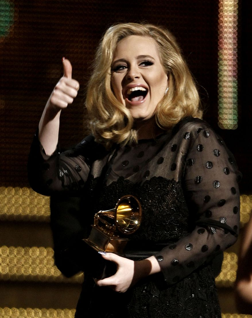 "Adele accepts the award for record of the year for ""Rolling in the Deep"" during the 54th annual Grammy Awards on Sunday, Feb. 12, 2012 in Los Angeles. (AP Photo/Matt Sayles)"