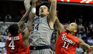 Georgetown's Nate Lubick (34) totaled seven points, eight rebounds, five assists and four blocks in a 71-61 Big East win over St. John's at Verizon Center. (Associated Press)