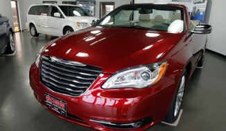 A 2012 Chrysler 200 convertible awaits a buyer in the showroom of Goss Dodge Chrysler in South Burlington, Vt. Dealers across the country are saying revenues are poised to grow this year. Chrysler said its sales in January rose 44 percent over 2011. (Associated Press)