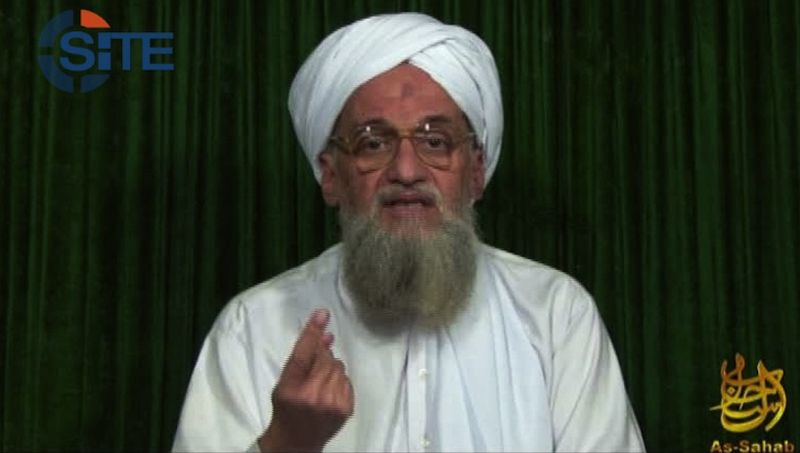 ** FILE ** This frame-grabbed image from video provided by the SITE Intel Group, an U.S. private terrorist-threat-analysis company, purports to show al Qaeda leader Ayman al-Zawahri on a Web posting on Sunday, Feb. 12, 2012. (AP Photo/SITE Intel Group)