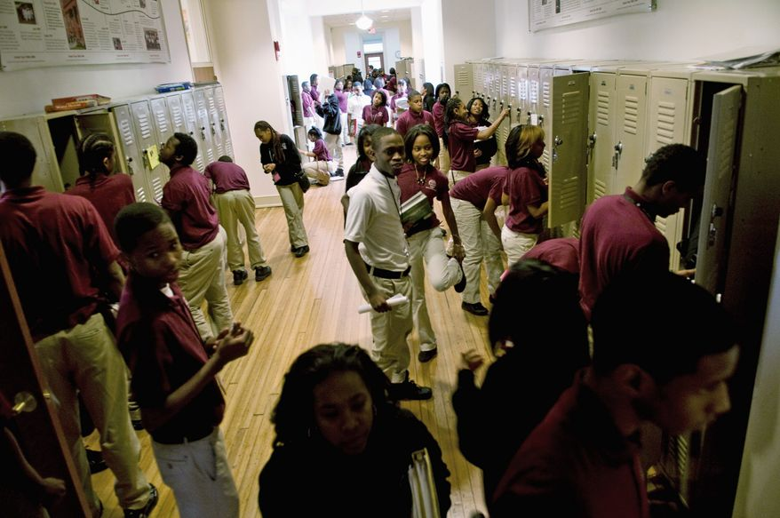 Students change classes on Dec. 8, 2010, at the Thurgood Marshall Academy Public Charter High School in the Anacostia neighborhood of Washington. (J.M. Eddins/The Washington Times) ** FILE **