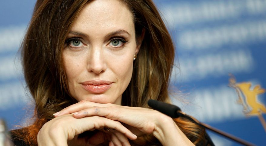 US director Angelina Jolie attends the press conference of the film In the Land of Blood and Honey at the 62 edition of the Berlinale, International Film Festival in Berlin Saturday, Feb. 11, 2012. (AP Photo/Michael Sohn)
