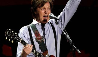 Paul McCartney during the 54th annual Grammy Awards on Sunday, Feb. 12, 2012 in Los Angeles. (AP Photo/Matt Sayles)