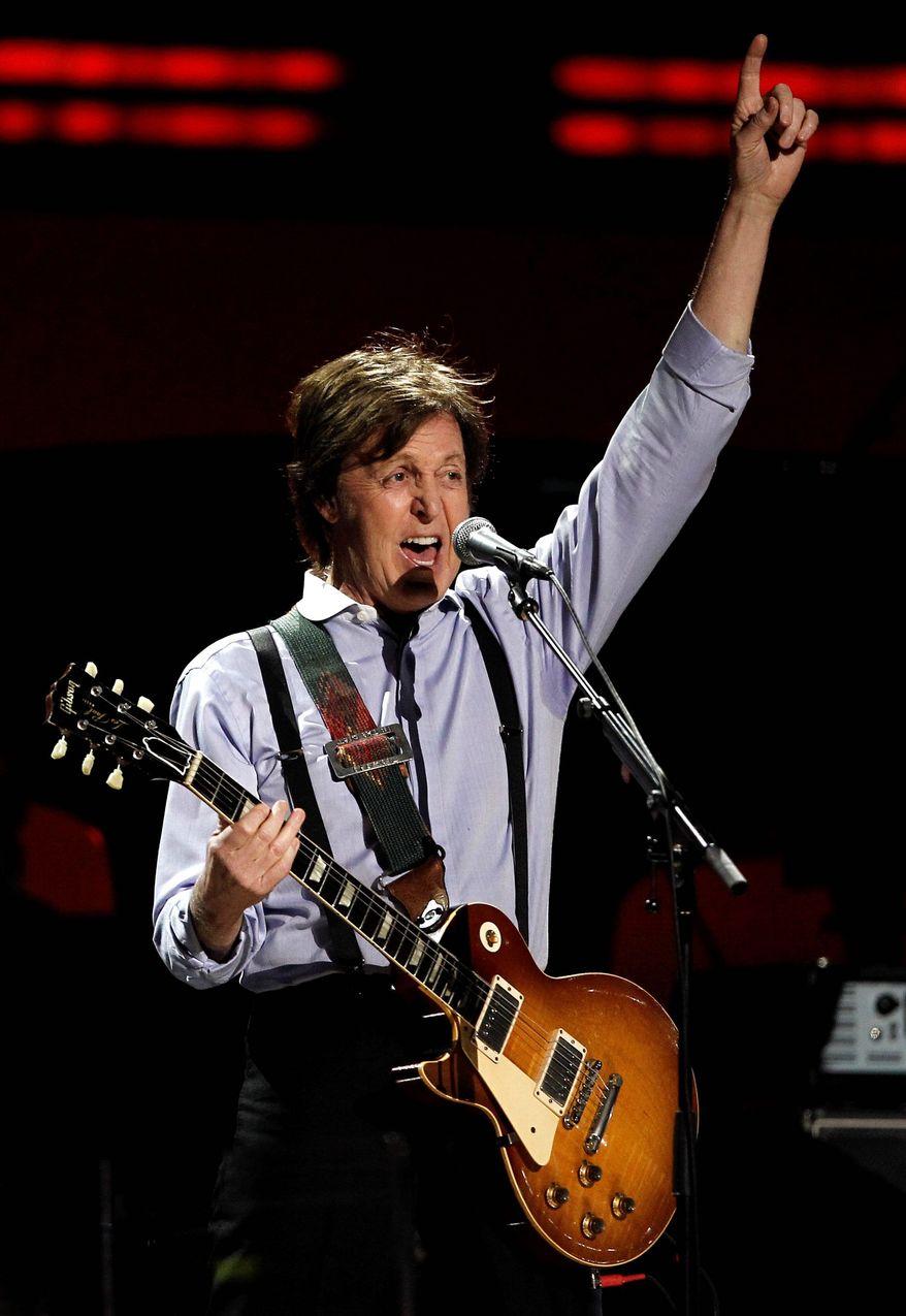 Paul McCartney during the 54th annual Grammy Awards on Sunday, Feb. 12, 2012 in Los Angeles. (AP Photo/Matt Sayles)
