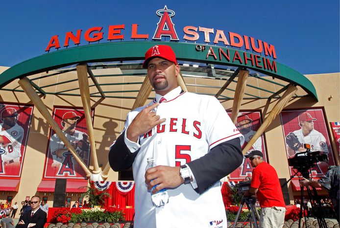 The Angels lured slugger Albert Pujols from St. Louis to the West Coast with a 10-year, $240 million deal. It was the biggest free agent signing off the offseason. (Associated Press)