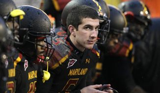 **FILE** Maryland quarterback Danny O'Brien looks on from the bench Oct. 29, 2011, during the second half of Boston College's 28-17 win over the Terps in College Park, Md. (Associated Press)
