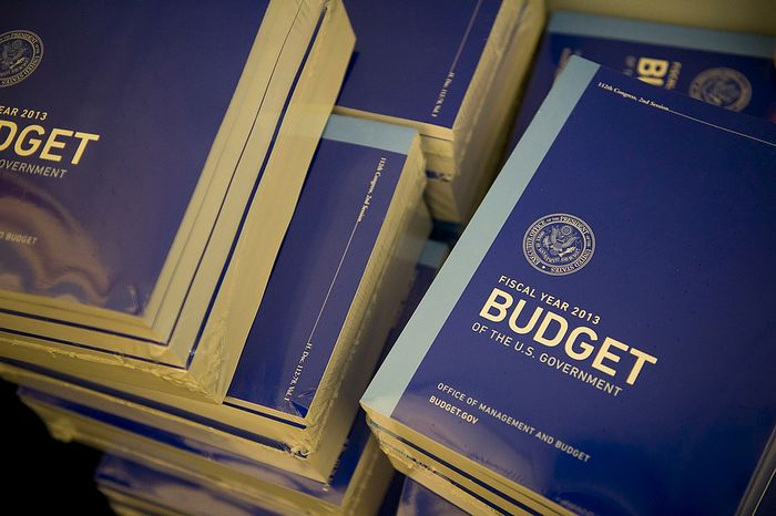 Copies of the fiscal 2013 budget are delivered and ready to be picked up on Feb. 13, 2012, at the Cannon House Office Building on Capitol Hill in Washington. (Rod Lamkey Jr./The Washington Times)
