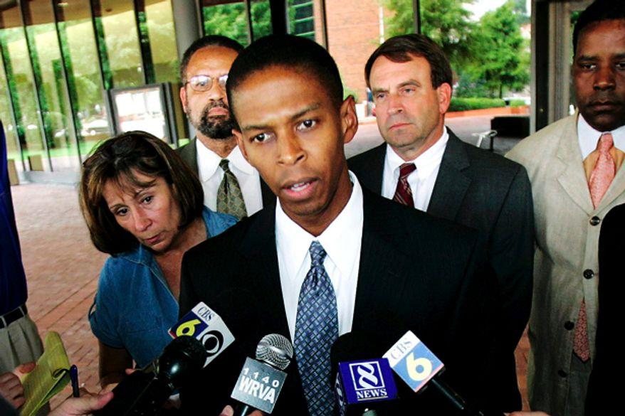 ** FILE ** Richmond Commonwealth's Attorney Michael Herring  (AP Photo/Steve Helber)