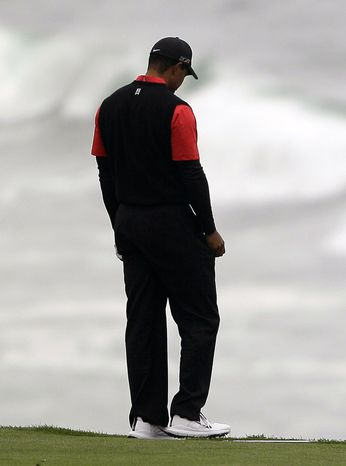Tiger Woods steps on his club after hitting from the ninth fairway at Pebble Beach Golf Links during the final round of the AT&T Pebble Beach National Pro-Am golf tournament in Pebble Beach, Calif., Sunday, Feb. 12, 2012. (AP Photo/Eric Risberg)