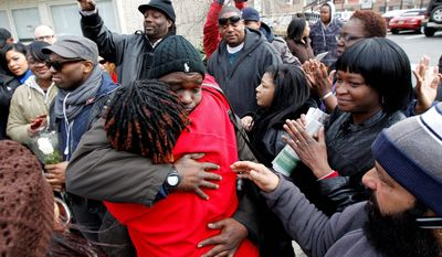 Whitney Houston fans gather outside Whigham Funeral Home in Newark, N.J. Miss Houston's funeral service is set for Saturday at Newark's New Hope Baptist Church, where Miss Houston sang. There will be no wake or public memorial. (Associated Press)