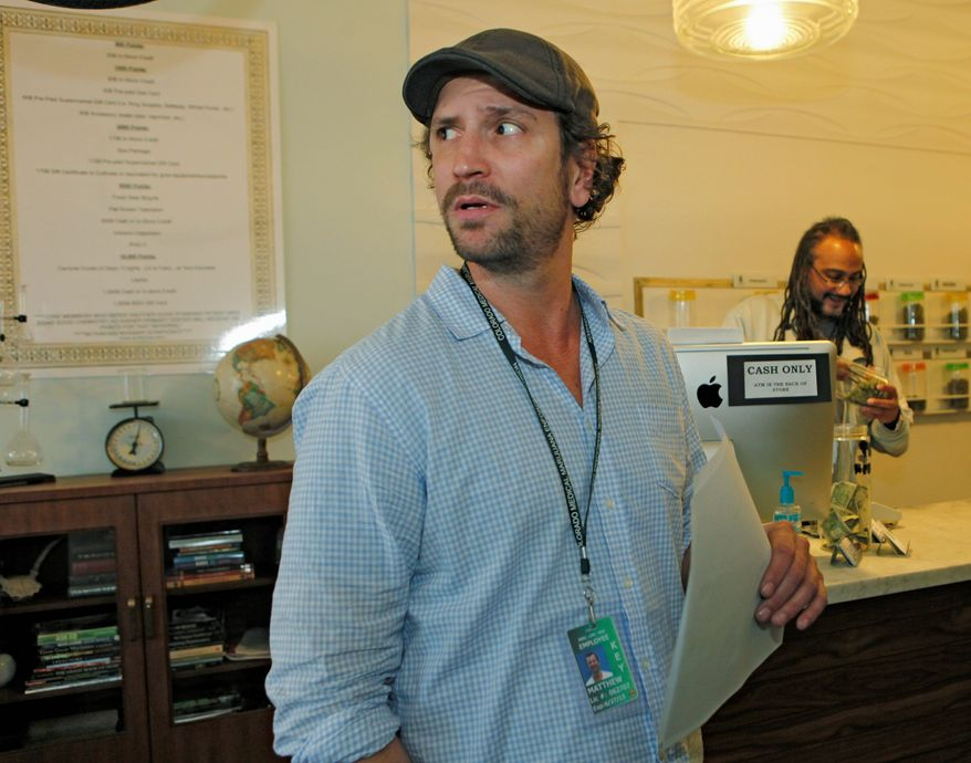 Matthew Huron, owner of two medical-marijuana dispensaries and an edible-marijuana company in Denver, pays his bills with money orders. That's because processing transactions or investments with pot money puts federally insured banks at risk of federal drug-racketeering charges. Mr. Huron's business is cash-only. (Associated Press)