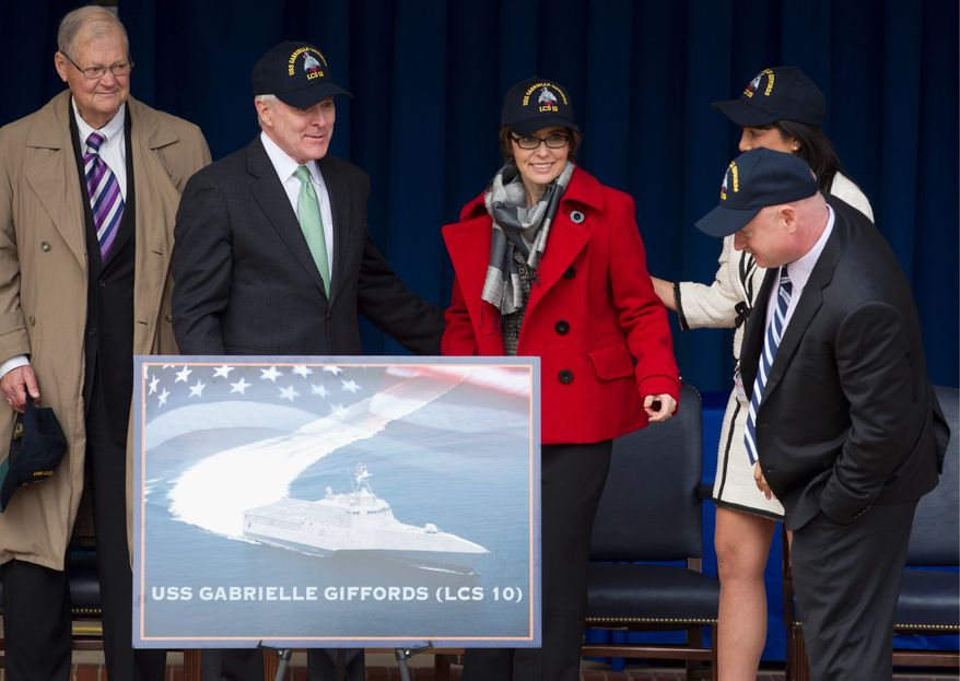 From left; Former Missouri Rep. Ike Skelton, Navy Secretary Ray Mabus, former Arizona Rep. Gabrielle Giffords, D-Ariz., her husband Mark Kelly, and Roxanna Green, obscured, the mother of the nine-year-old Christina-Taylor Green who was killed while attending the meeting of constituents when Giffords was shot, attend a ceremony at the Pentagon, Friday, Feb. 10, 2012, to unveil the USS Gabrielle Giffords. The Navy has named a ship for Gabrielle Giffords, the recently retired congresswoman from Arizona who is recovering from a gunshot wound to the head received in January 2011. (AP Photo Manuel Balce Ceneta)