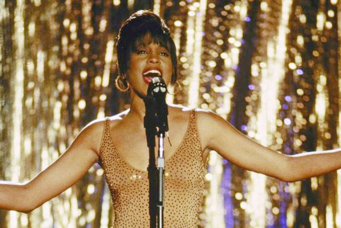 "Whitney Houston starred in the 1992 film ""The Bodyguard,"" which featured Miss Houston's biggest hit, the Dolly Parton-penned ""I Will Always Love You."" (Warner Brothers)"