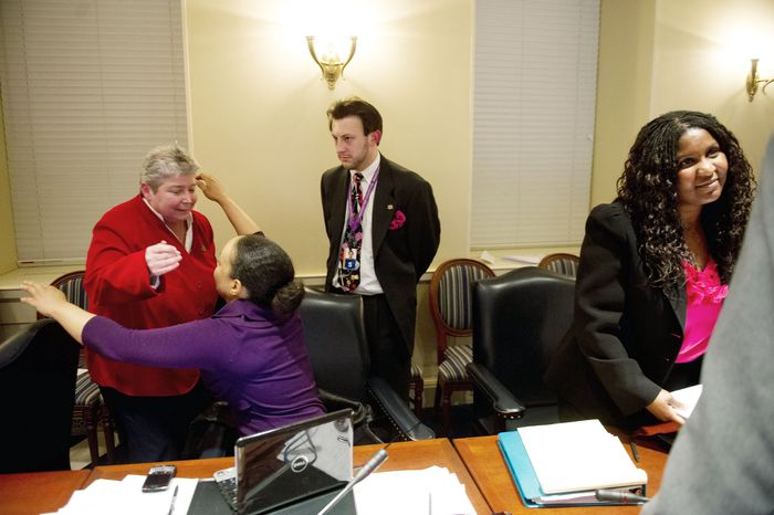Democratic Delegates Bonnie L. Cullison (left), of Montgomery County, and Jill P. Carter, of Baltimore, exult after a bill to legalize same-sex marriage jointly passed two Maryland House committees Tuesday. (Andrew Harnik/The Washington Times)