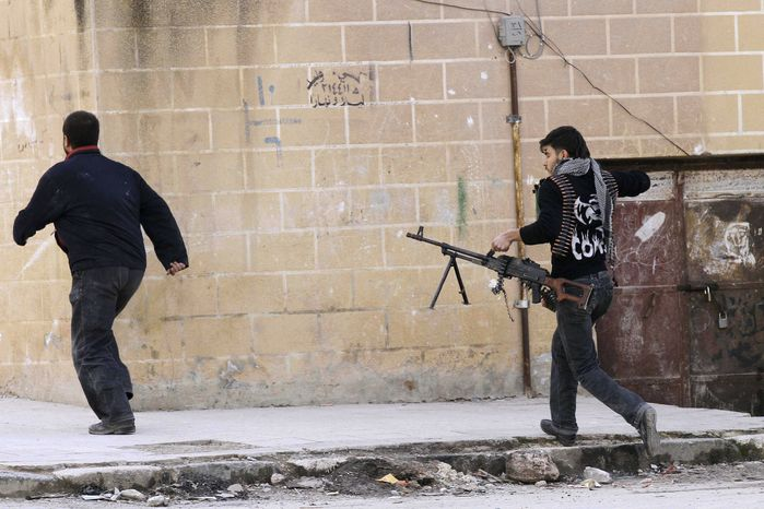 Syrian rebels are seen after government tanks entered the northwestern city of Idlib, Syria, on Tuesday, Feb. 14, 2012. (AP Photo)
