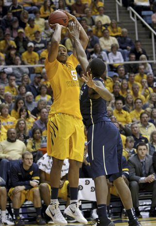West Virginia's Kevin Jones shoots over Pittsburgh's Lamar Patterson during the second half at WVU Coliseum in Morgantown, W.Va., on Monday, Jan. 30, 2012. Pittsburgh won 72-66. (AP Photo/David Smith)