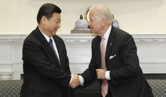 Vice President Joseph R. Biden Jr. meets with Chinese Vice President Xi Jinping in the Roosevelt Room at the White House in Washington on Tuesday, Feb. 14, 2012. (AP Photo/Charles Dharapak)