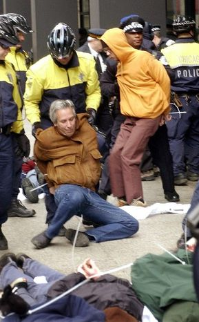 ASSOCIATED PRESS Chicago police arrest activists during a 2003 anti-war demonstration. A city alderman is pushing an ordinance barring electronic-device blackouts by police at the May G-8 and NATO summits.