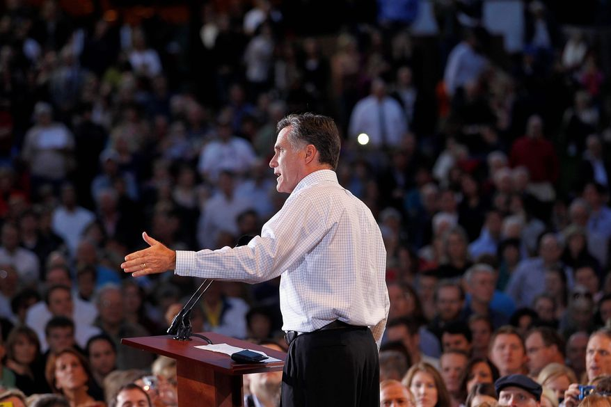 Republican presidential hopeful Mitt Romney speaks at a campaign rally in Mesa, Ariz., on Monday. Arizona holds its GOP presidential primary on Feb. 28, the same day as Michigan, the home state of the former Massachusetts governor. (Associated Press)