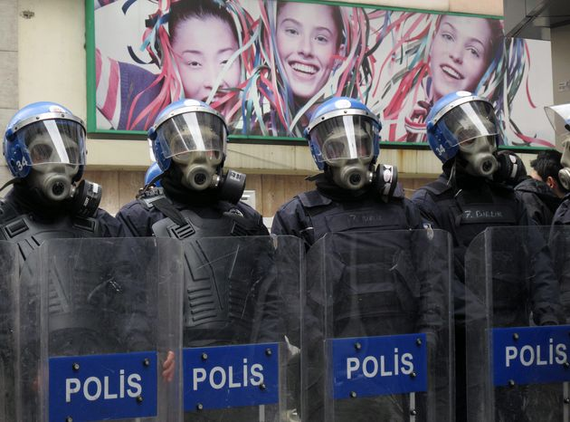Turkish riot police stand guard as Kurdish protesters gather for a demonstration in Istanbul on Wednesday to mark the anniversary of the 1999 capture of Abdullah Ocalan, then head of the Kurdish rebel group PKK. (Associated Press)