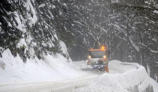 A snowplow clears a road on Wednesday, Feb. 15, 2012, near Harrachov, Czech Republic, in the Krkonose Mountains, 80 miles northeast of Prague. (Associated Press/CTK)