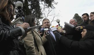 Greek Finance Minister Evangelos Venizelos (center) speaks Feb. 15, 2012, to the press after a meeting with the Greek President Karolos Papoulias in Athens. (Associated Press)