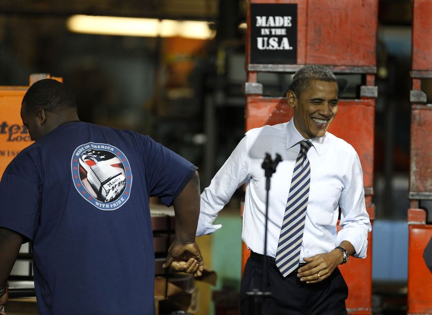 President Obama shakes hands with DiAndre Jackson as he is introduced Feb. 15, 2012, at the Master Lock Company in Milwaukee, where he spoke about the importance of American manufacturing. (Associated Press)