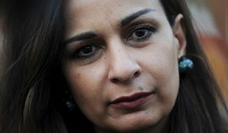 ** FILE ** Former Pakistani Information Minister Sherry Rehman listens to reporters in Islamabad, Pakistan, on Wednesday, Nov. 23, 2011. Pakistan has appointed Ms. Rehman, a democracy advocate who has faced militant death threats, as its new ambassador to the United States. (AP Photo/B.K. Bangash)