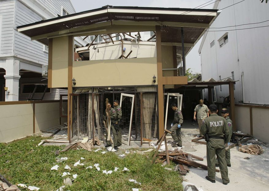 On Wednesday, Feb. 15, 2012, Thai Explosive Ordnance Disposal (EOD) officials examine the damage caused by a blast at the house where suspected bomber Saeid Moradi was staying in Bangkok. (AP Photo/Sakchai Lalit)