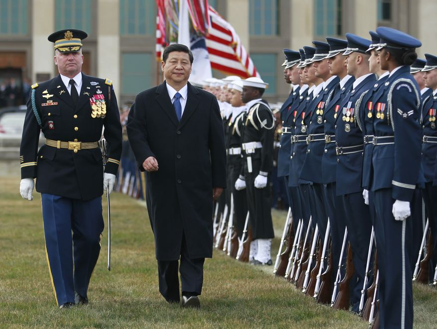 Chinese Vice President Xi Jinping reviews the troops during a full honors ceremony on Feb. 14, 2012, at the Pentagon in Arlington. (Associated Press)