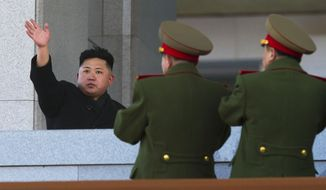 New North Korean leader Kim Jong-un waves at Kumsusan Memorial Palace in Pyongyang, North Korea, after reviewing a parade of thousands of soldiers to commemorate the 70th birthday of his late father, Kim Jong-il, on Thursday, Feb. 16, 2012. (AP Photo/David Guttenfelder)