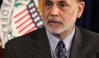 **FILE** Federal Reserve Chairman Ben Bernanke takes part in a news conference Jan. 25, 2012, at the William McChesney Martin Federal Reserve Board Building in Washington. (Associated Press)