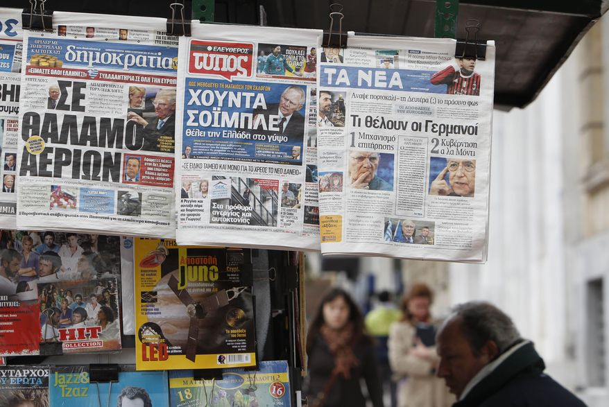 """The front pages of three Greek newspapers, depicting German Finance Minister Wolfgang Schaeuble (from left), read Dimokratia (""""In the gas chamber""""), Eleftheros Typos (""""Schaeuble's Junta"""") and Ta Nea (''What the Germans want"""") in Athens on Feb. 16, 2012. (Associated Press)"""