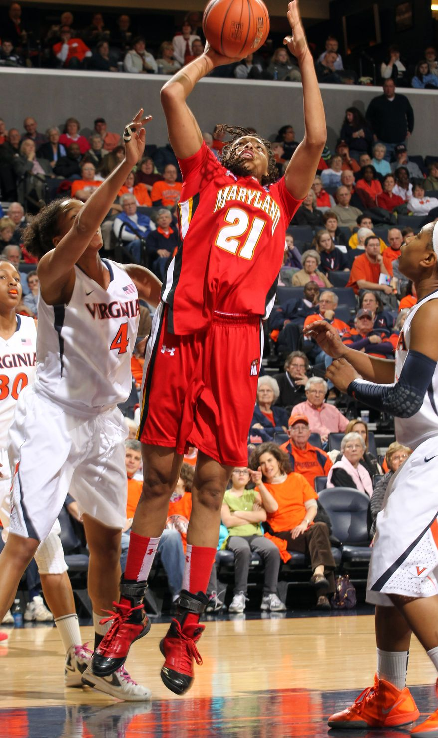 Maryland forward Tianna Hawkins shoots over Virginia center Simone Egwu during the first half Thursday, Feb. 16, 201,2 in Charlottesville, Va. (AP Photo/Andrew Shurtleff)
