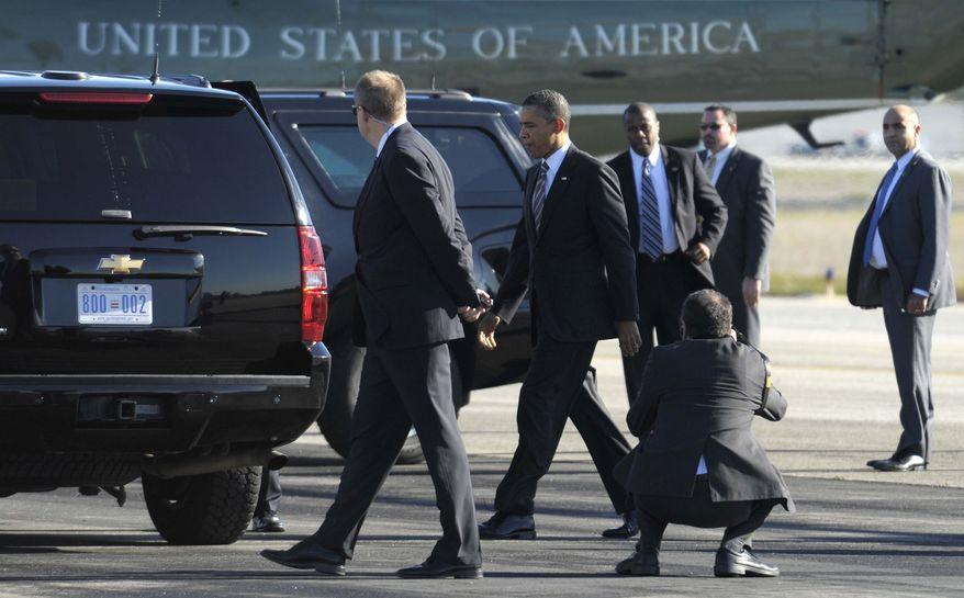President Barack Obama walks off of Marine One at John Wayne Airport in Santa Ana, Calif., Thursday, Feb. 16, 2012, to attend a fundraiser. (AP Photo/Susan Walsh)