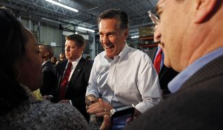 Former Massachusetts Gov. Mitt Romney greets supporters at a campaign rally in Kentwood, Mich., Wednesday, Feb. 15, 2012. (AP Photo/Gerald Herbert)