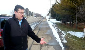 On Wednesday, Feb. 15, 2012, Mike Vega points to the area in Madison, Wis., where on Feb. 6 he found a severely malnourished 15-year-old after she had escaped from an unfinished basement in which, authorities say, she was forced to stay for years. (AP Photo/Todd Richmond)