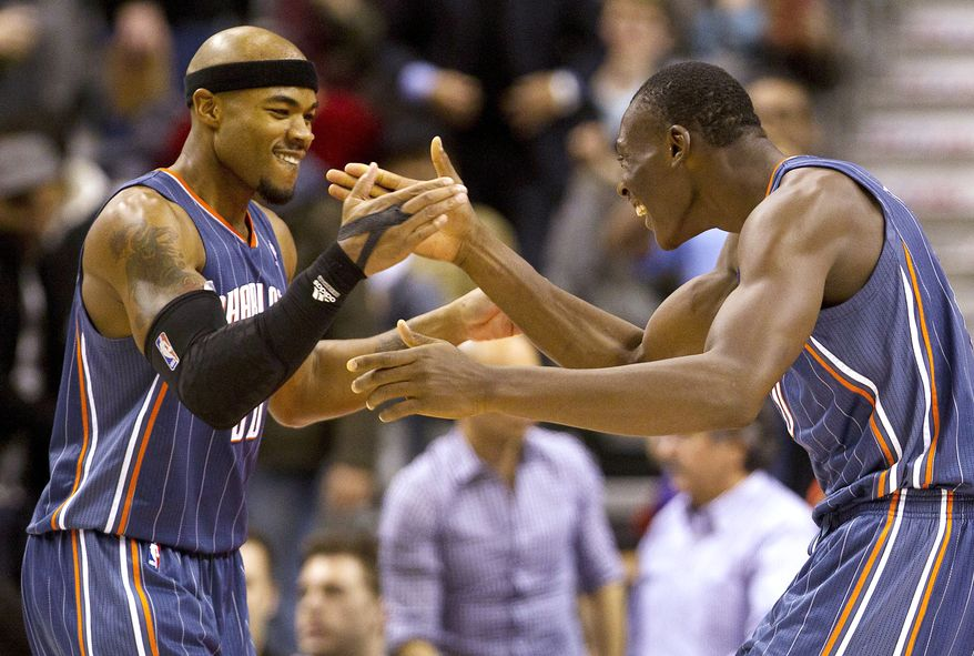 Charlotte Bobcats forwards Bismack Biyombo, right, and Corey Maggette, left, celebrate their 98-91 win over the Toronto Raptors on Friday, Feb. 17, 2012, in Toronto. (AP Photo/The Canadian Press, Frank Gunn)