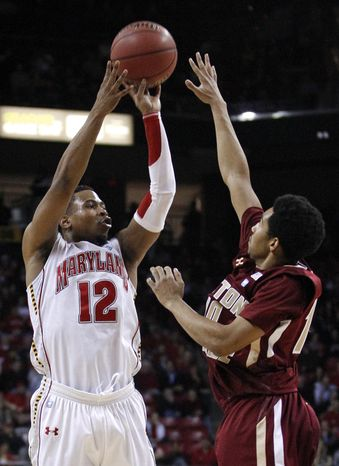 Maryland guard Terrell Stoglin shoots over Boston College guard Jordan Daniels in the first half of Maryland's 81-65 home win on Feb. 16, 2012. (Associated Press)