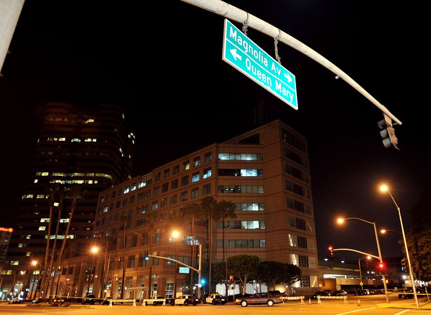 Streets surrounding the federal building on Ocean Boulevard in downtown Long Beach are closed Feb. 16, 2012, after an ICE agent shot and injured another agent and was then killed by a third colleague in the building according to the FBI. (Associated Press/Long Beach Press Telegram)
