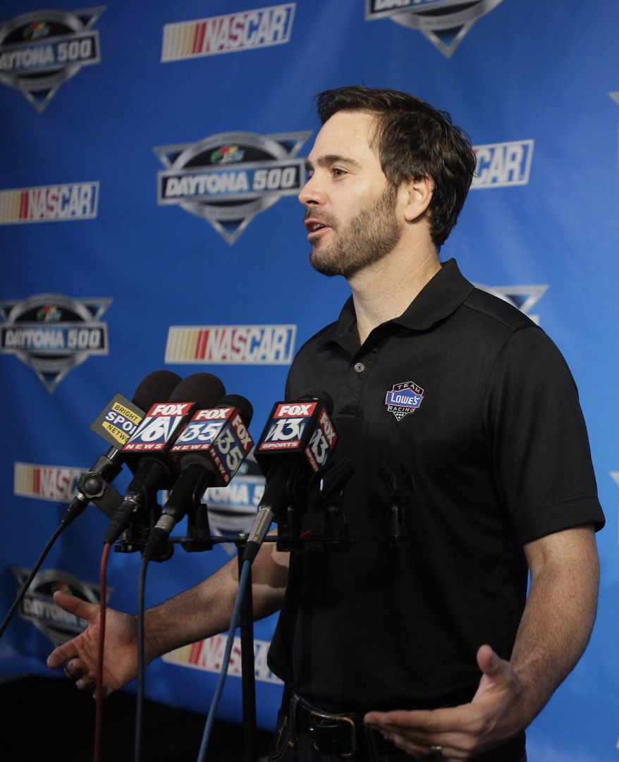 Auto racing driver Jimmie Johnson answers questions during an interview at NASCAR media day at Daytona International Speedway, Thursday, Feb. 16, 2012, in Daytona Beach, Fla. (AP Photo/John Raoux)