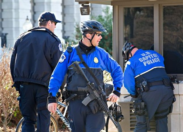 U.S. Capitol Police officers keep watch after a 29-year-old Moroccan man was arrested Friday in an FBI sting operation near the Capitol while planning to detonate what police said he thought were live explosives, in Washington, Friday, Feb. 17, 2012. (AP Photo/J. Scott Applewhite)