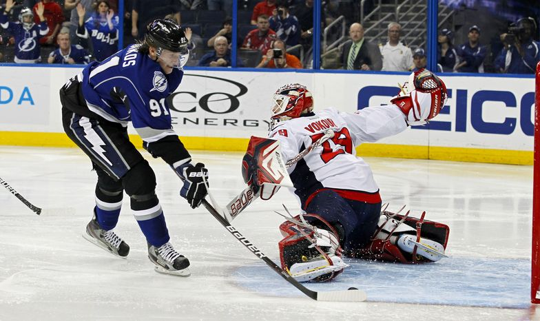 Tampa Bay Lightning's Steven Stamkos scores against Washington Capitals goalie Tomas Vokoun during the second period Saturday, Feb. 18, 2012, in Tampa, Fla. (AP Photo/Mike Carlson)