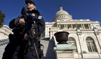 Capitol Police officer Trevor O'Neill stands on guard on the west side of the Capitol in Washington Friday, Feb. 17, 2012. A 29-year-old Moroccan man was arrested Friday in an FBI sting operation near the U.S. Capitol while planning to detonate what police say he thought were live explosives. (AP Photo/Manuel Balce Ceneta)
