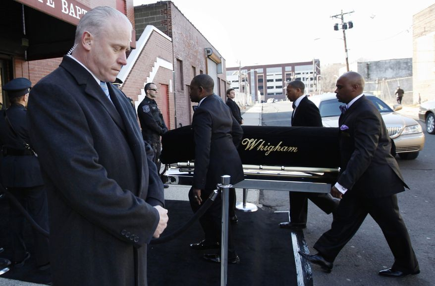 A coffin holding the remains of singer Whitney Houston is carried into the New Hope Baptist Church before her funeral services in Newark, N.J., on Saturday, Feb. 18, 2012. (AP Photo/Jason DeCrow)