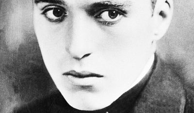 FILE - In this 1914 file photo, actor Charlie Chaplin is seen when he was a player in Fred Karno's vaudeville troupe, at an unknown location. Although the entertainer is celebrated as one of London's most famous sons, newly declassified files reveal that Britain's MI5 domestic intelligence service found no records to back up Chaplin's claim that he was born in the city on April 16, 1889. Uncertainty about Chaplin's origins linger to this day - a mystery Chaplin himself may have helped to nurture. (AP Photo, File)