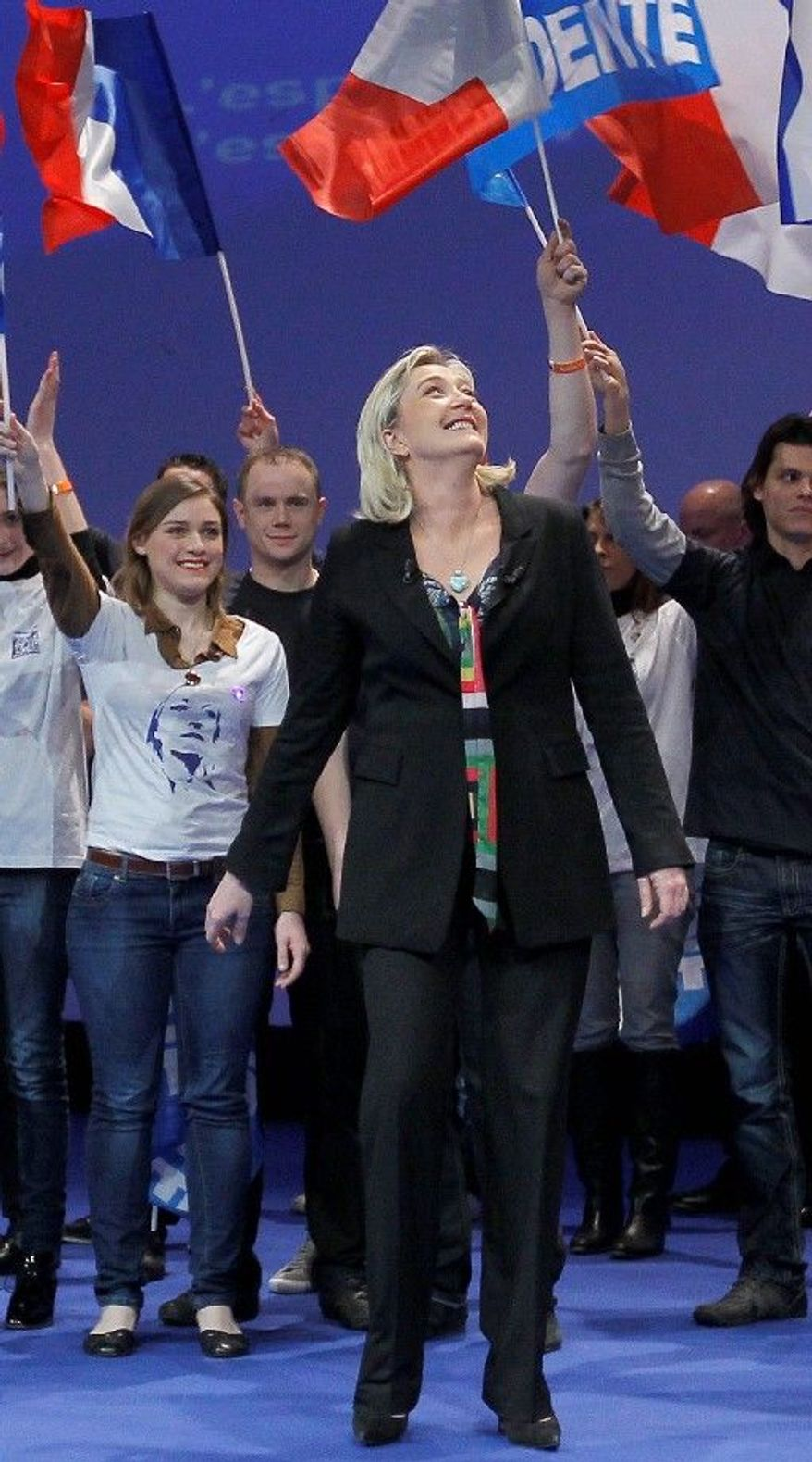 Marine Le Pen, at the National Front party's convention in Lille on Sunday, took over leadership of party last year from her father, Jean-Marie Le Pen, and is a candidate with some following in the 2012 French presidential elections. Polls show her not far behind incumbent Nicolas Sarkozy. (Associated Press)
